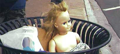 Doll in the trash.
